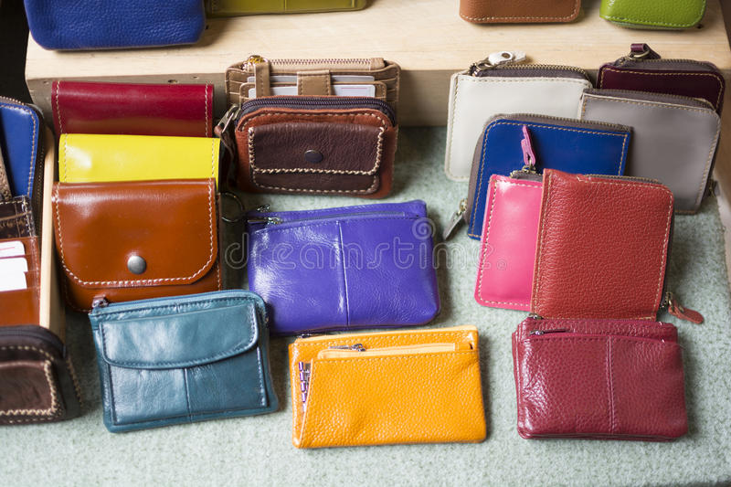 Different color of billfold in the market. Miscellaneous shop stock photo