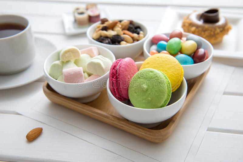 Different color sweets on bowl stock image