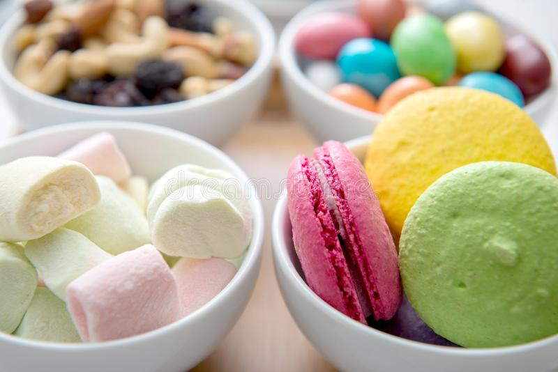 Different color sweets on bowl royalty free stock image