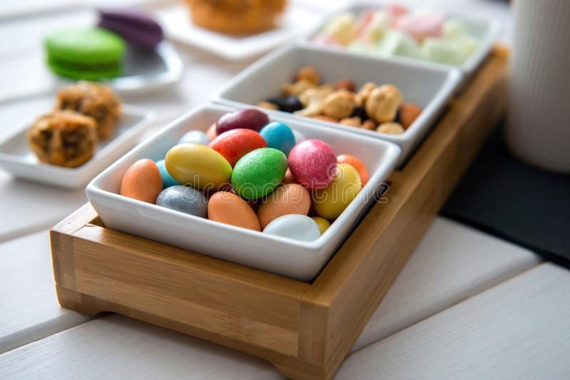 Different color sweets on bowl stock images