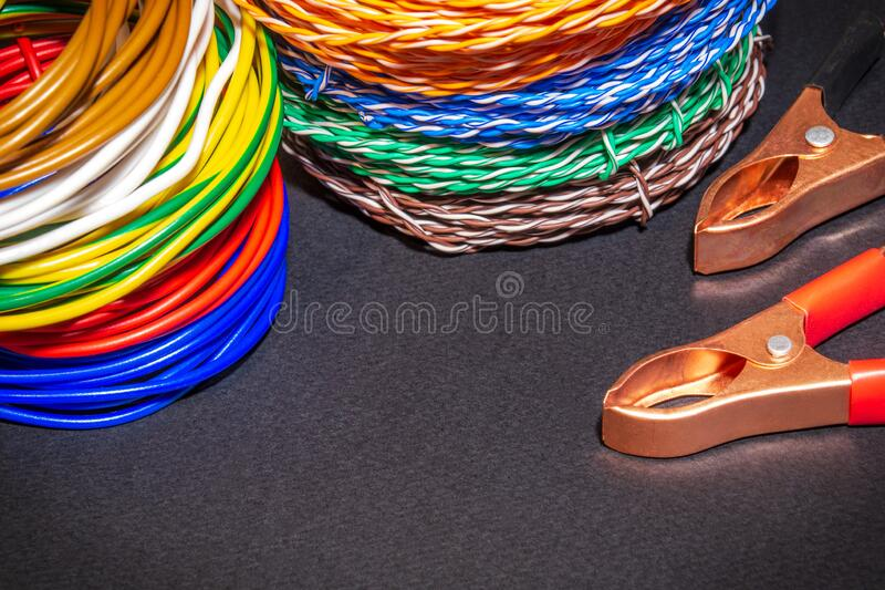Different color wires and alligator clips prepared for master electrician stock photo