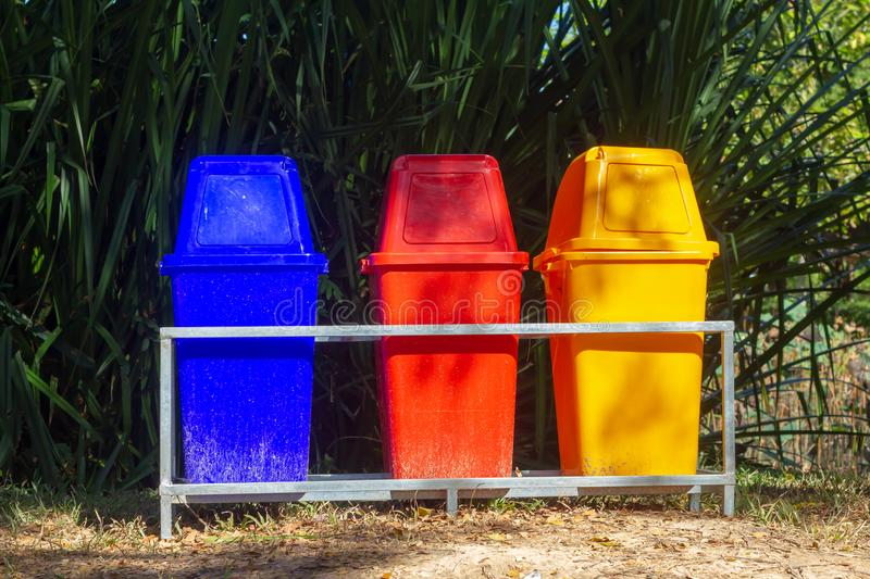 Different Colored Bins For Collection Of Recycle Materials royalty free stock photo