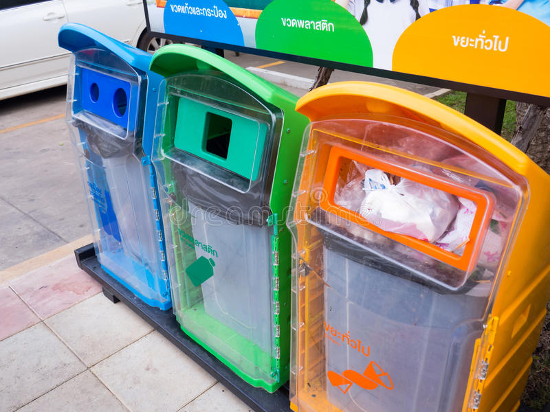 Different Colored Bins For Collection Of Recycle Materials with waste icon. Different Colored Bins For Collection Of Recycle Materials with waste icon royalty free stock photos