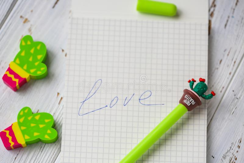 A different colored eraser and a pencil on a white background. General goods.  stock photo