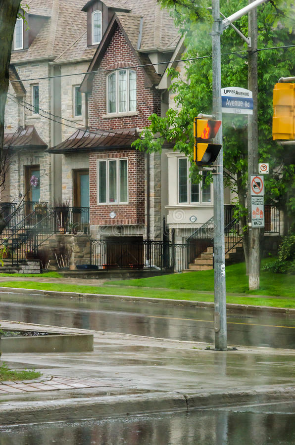 Different colored facades of houses in Toronto. Toronto, Canada - 26 may 2013: Different colored facades of houses in the area of Toronto under the rain during stock images