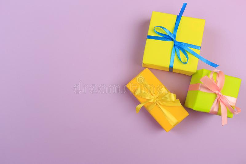 Different colored gift box on color background. Top view of various present boxes on minimal background. Birthday, Christmas, royalty free stock photos