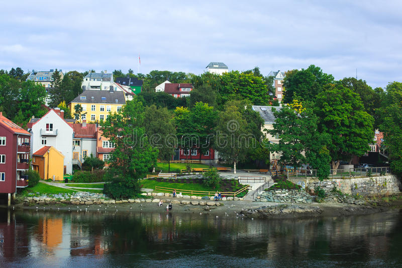 A different colored houses in Trondheim, Norway. Trondheim panoramic view with different colored houses and embankment, Norway stock images