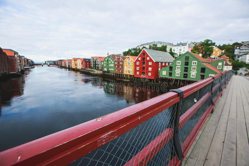 A different colored houses in Trondheim, Norway. Trondheilm panoramic view with different colored houses and embankment, Norway stock image