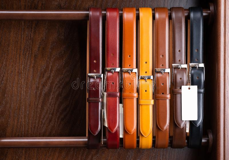Different colored leather belts stock image