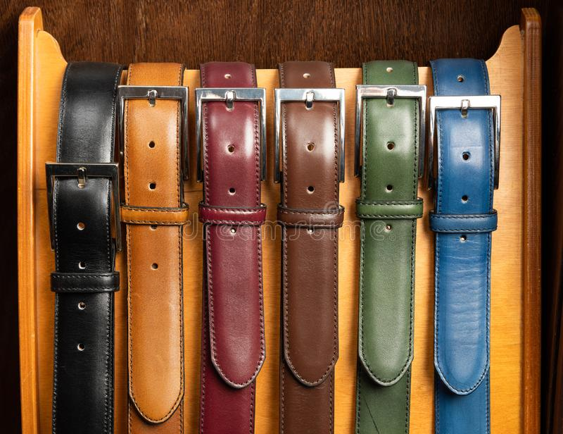 Different colored leather belts royalty free stock images
