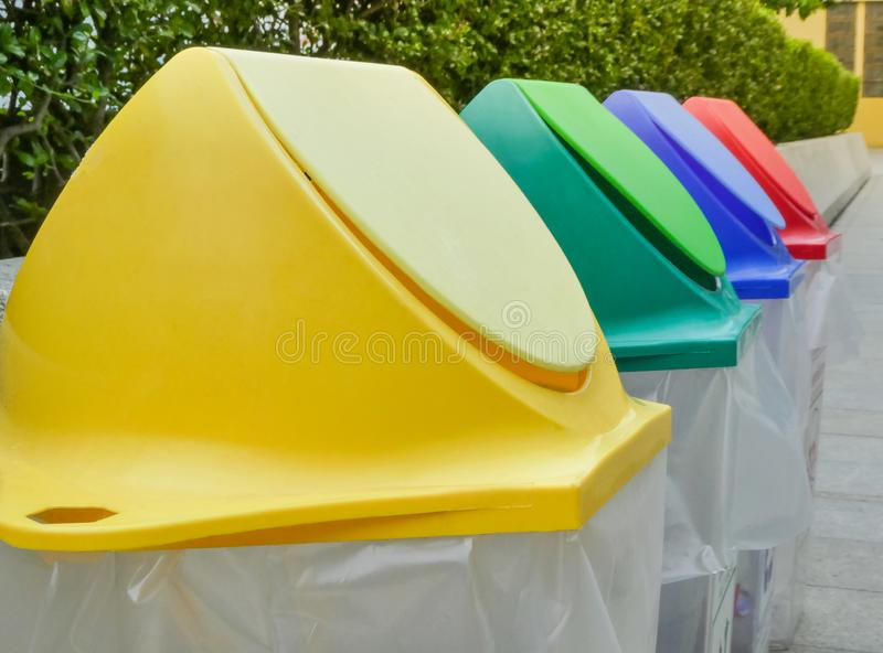 Different colored recycle garbage trash Bins in the park. royalty free stock photo