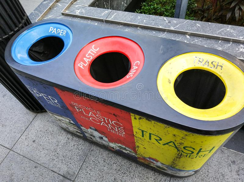 Different colored recycle garbage trash Bins on Shopping street at Orchard road. stock photo