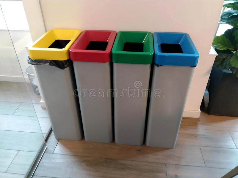 Different colored recycle waste bins. Organic, batteries, metal plastic paper, glass, e-waste, light bulbs royalty free stock photos
