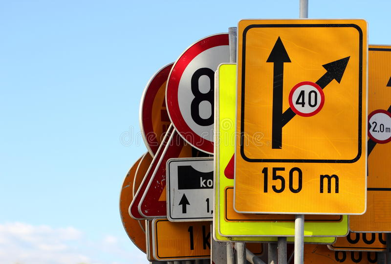 Different colored traffic signs stock photo