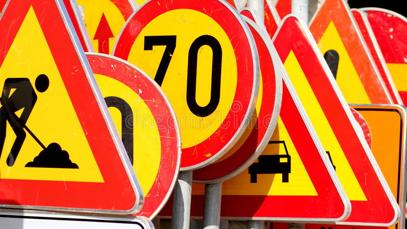 Different colored traffic signs royalty free stock photography