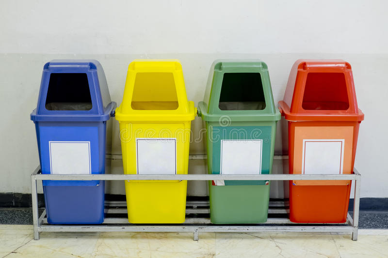 Different Colored wheelie bins set with waste icon. Closeup Different Colored wheelie bins set with waste icon royalty free stock photo