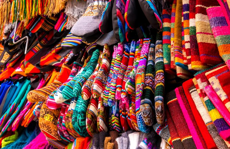 Different colorful laces on the souvenir store in Bolivia. Different colorful laces with patterns hanging on the souvenir store in Bolivia royalty free stock photos