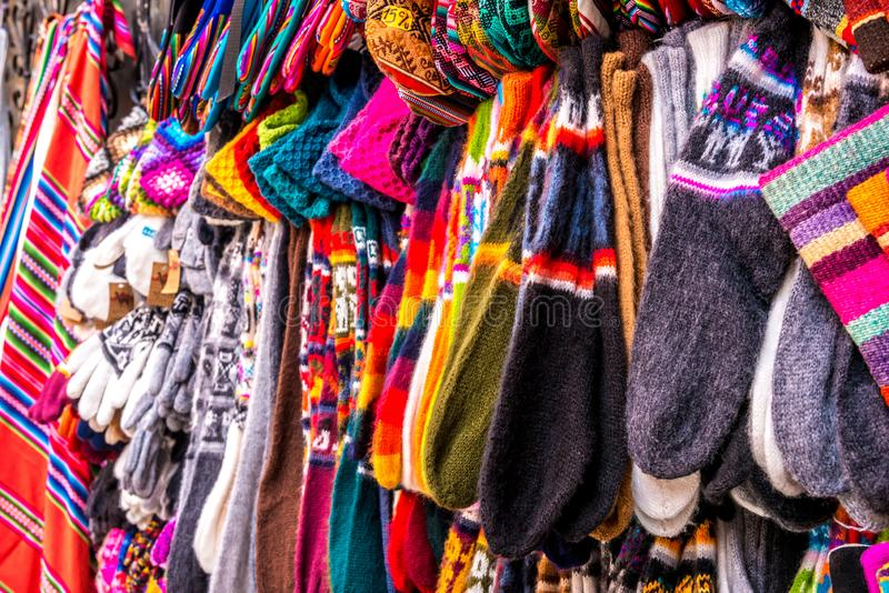 Different colorful laces on the souvenir store in Bolivia. Different colorful laces with patterns hanging on the souvenir store in Bolivia royalty free stock photo