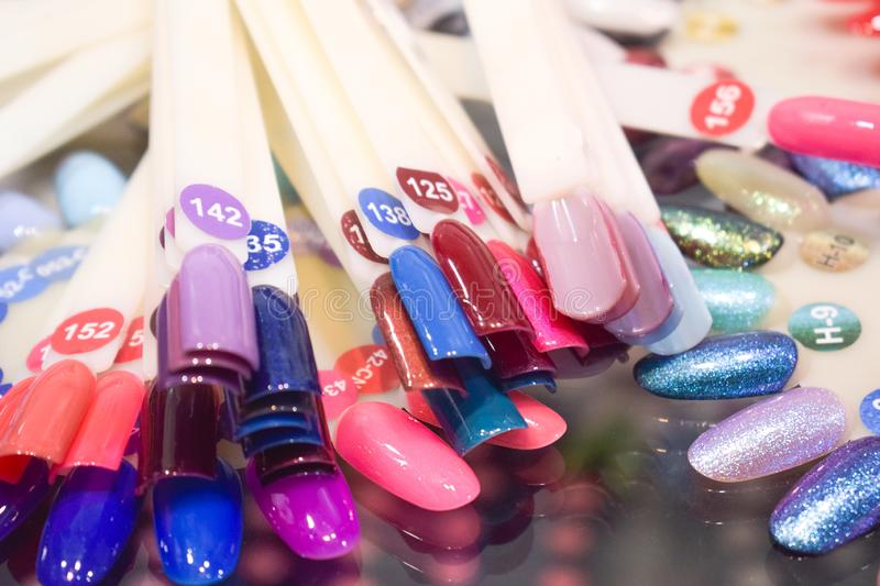 Different colorful nails polish manicure palette Background. Samples of nail varnishes. False Display Nail Art Fan Wheel Polish Pr stock photo