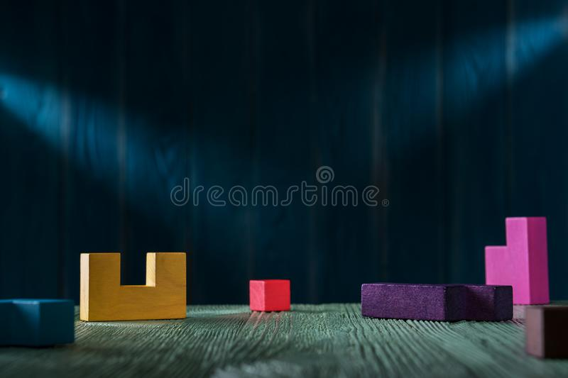 Different colorful shapes wooden blocks on blue background royalty free stock image