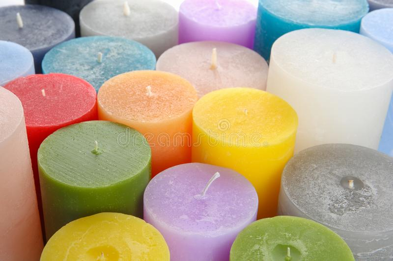 Different colorful wax candles. Close up view stock image