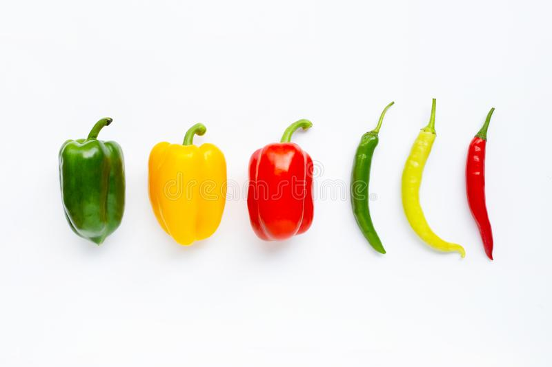 Different colors bell peppers and chili peppers isolated on white royalty free stock photography