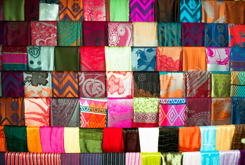 Different colors silk textile stand royalty free stock photo