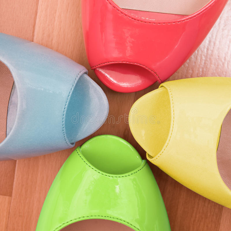 Different colour shoes background stock photography