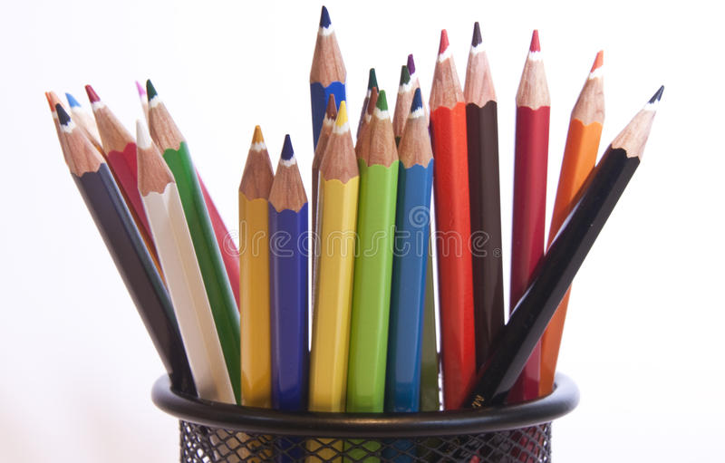 Different coloured pencils stood in pot stock image