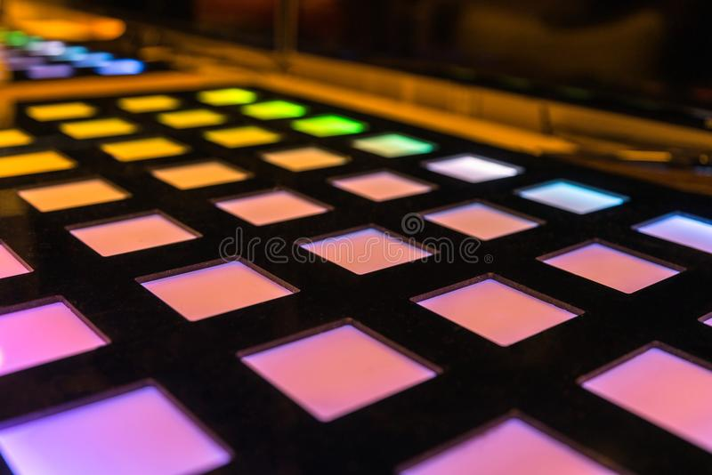 Different coloured squares , glowing lights, technology. Different coloured squares, glowing lights, technology. Tech gathering exposition event stock photos
