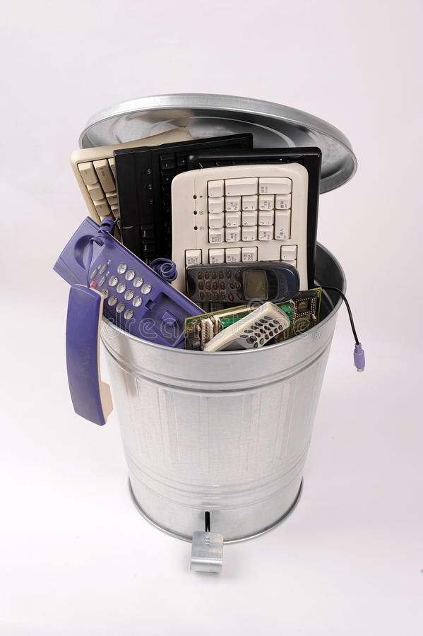 Different computer parts in trash can stock photos