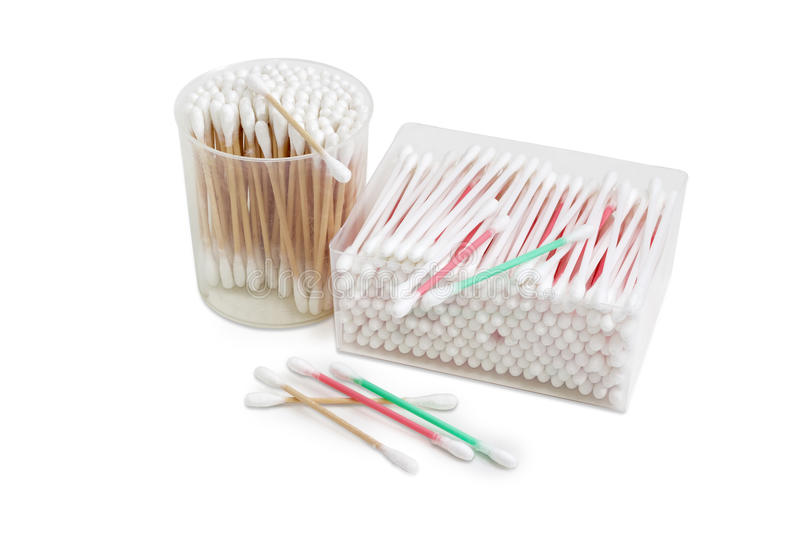 Different cotton swabs in two rectangular and round plastic cont stock image