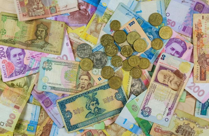 Different currency bills creating a colorful background royalty free stock images