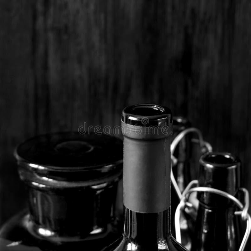 Different dark glass bottles for alcoholic drinks stock images
