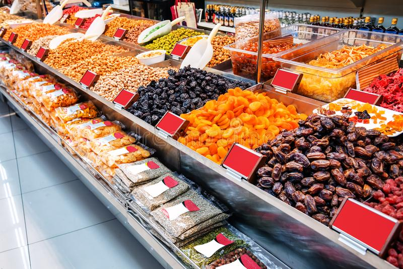 Different dried fruits in the store stock images