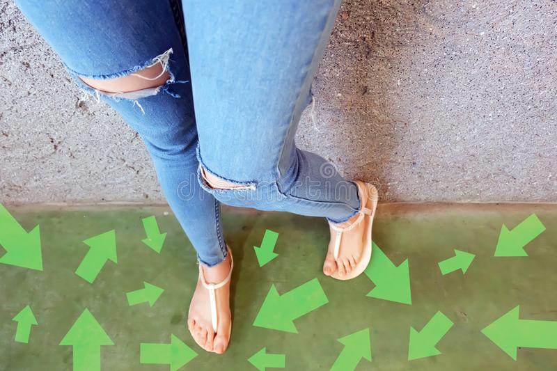 Different Direction Arrows to the Future. Selfie Above Woman Standing with Green Arrow Line Choices. Shoes Woman Footwear and ar. Rows on Street Road in The City royalty free stock images