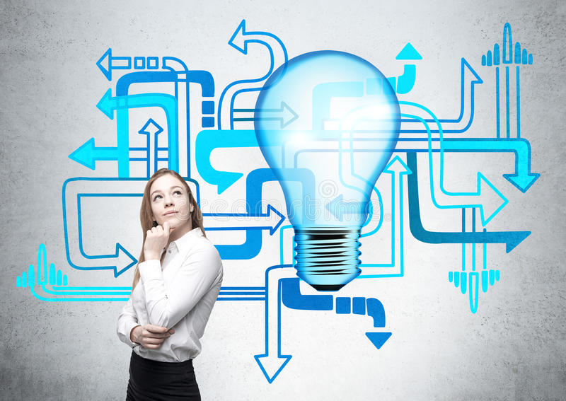 Different direction businesswoman lightbulb. Different direction concept with thoughtful businesswoman next to abstract blue arrows and lightbulb on concrete stock image