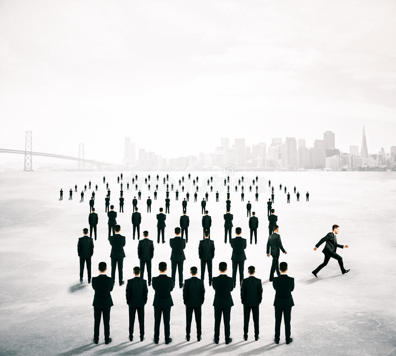 Different direction concept people. Different deirection concept with arrow shaped crowd of businesspeople going in one direction and just one person walking royalty free stock photos