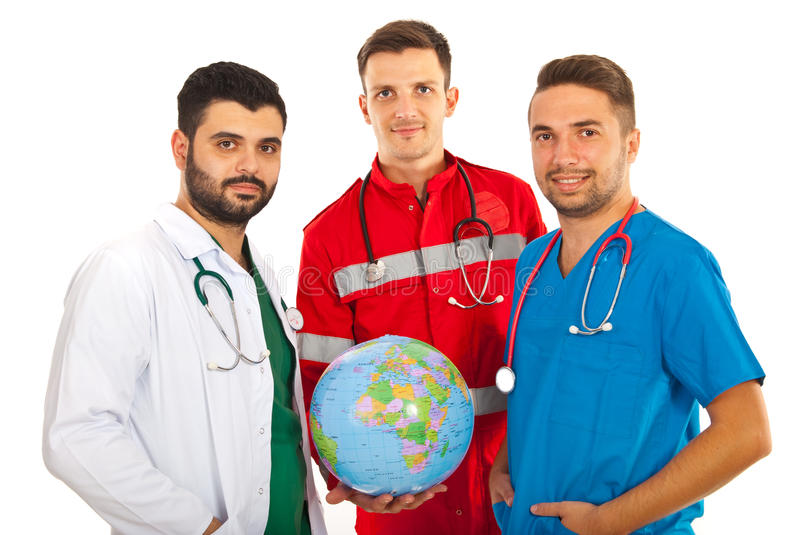 Different doctors holding globe. Different doctors males holding world globe isolated on white background royalty free stock photography