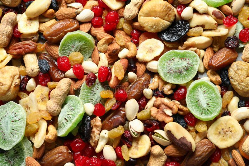 Different dried fruits and nuts as background royalty free stock photos