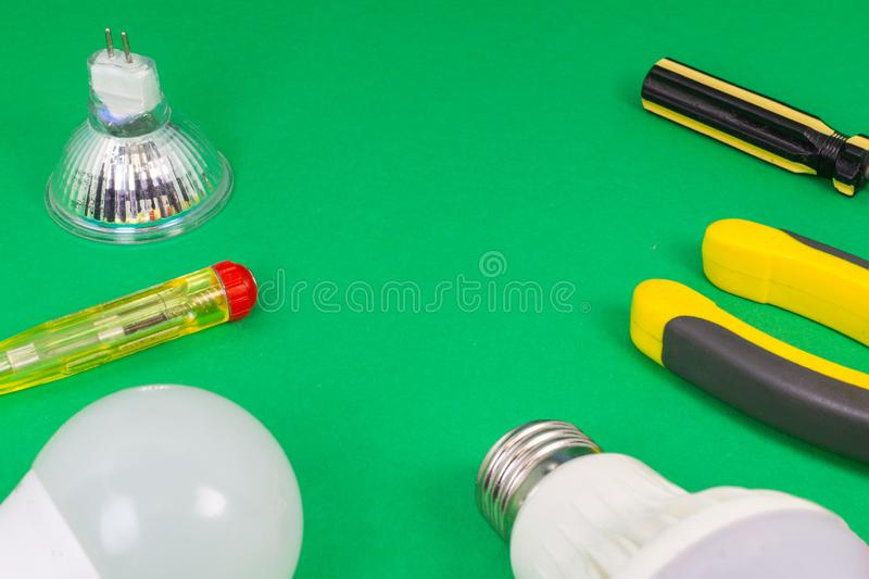 Different electrical tools on light green background royalty free stock images