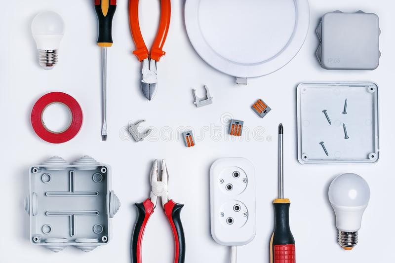 Different electrical tools on light grey background, top view. royalty free stock photos