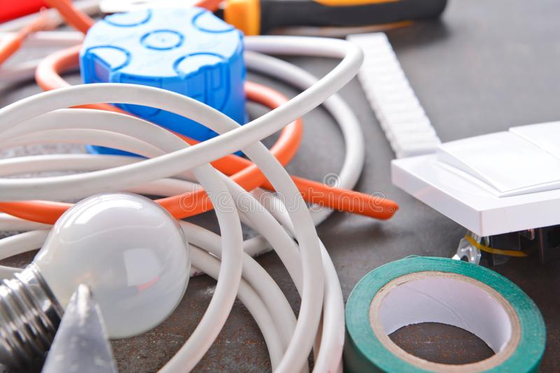 Different electrician's supplies on table royalty free stock photos
