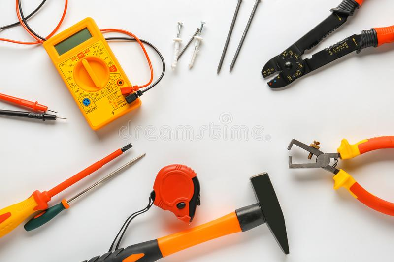 Different electrician\'s tools and supplies on white background royalty free stock image