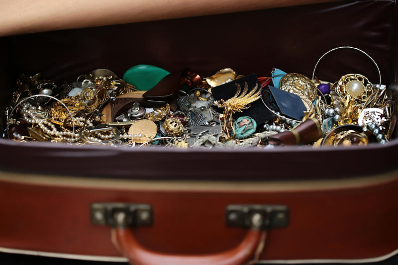 Different fashion bijouterie in suitcase royalty free stock photo