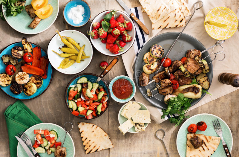 Different food cooking on the grill. Dinner table concept royalty free stock images