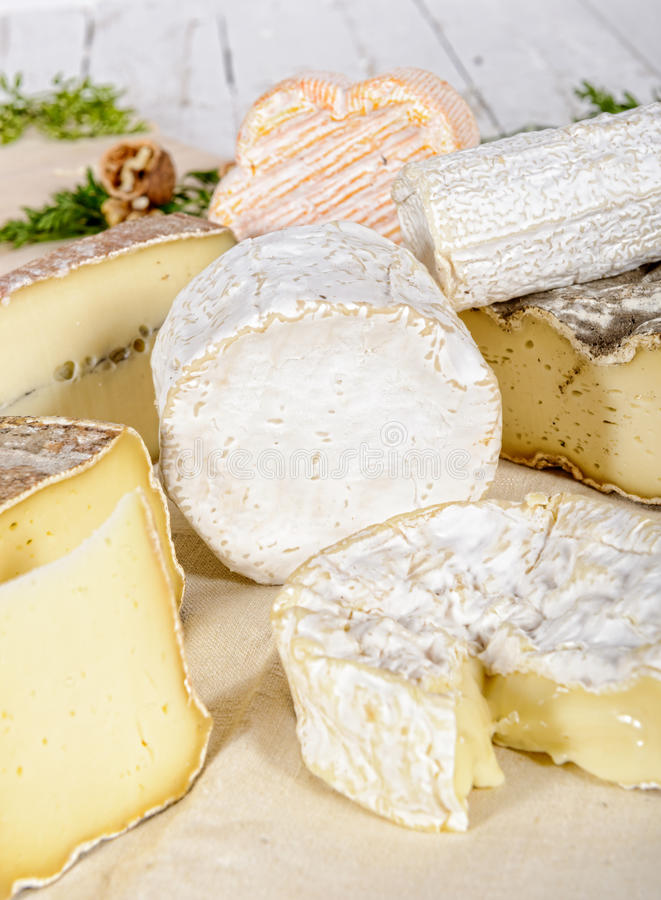 Different french cheeses. Placed on old white table stock photos
