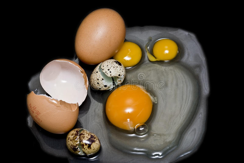 Different fresh eggs for an omelet. Some cracked eggs to make an omelet stock images