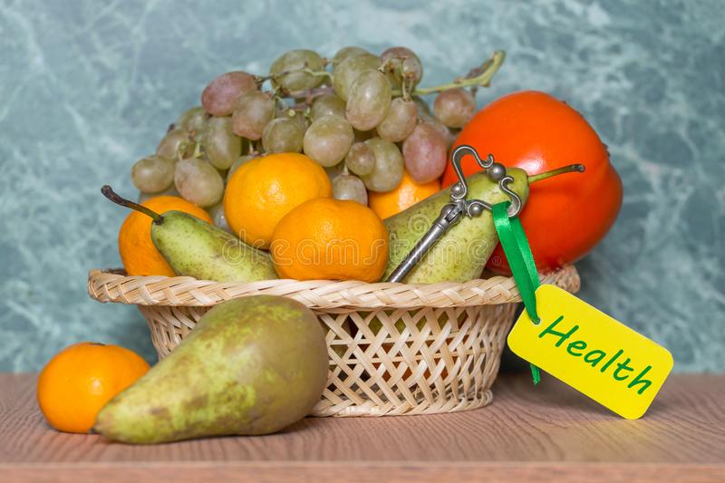 Different fruit and key to health concept stock photography