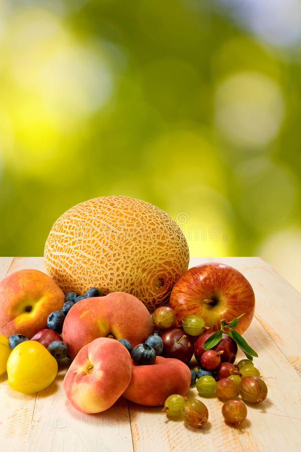 Different fruits on green background. Image of different fruits on green background royalty free stock image
